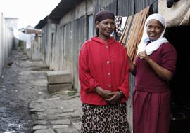 Hawa and Musra Mohammed outside their single-room home in Mukuru informal settlement, Nairobi, Kenya, March 2014. Credit: Sam Tarling